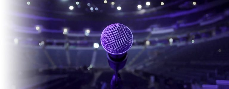 A microphone on stage in a large venue
