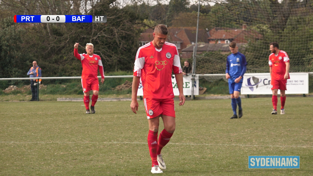 A Portland United player walks with his head down at the Wessex Premier League Final 2019