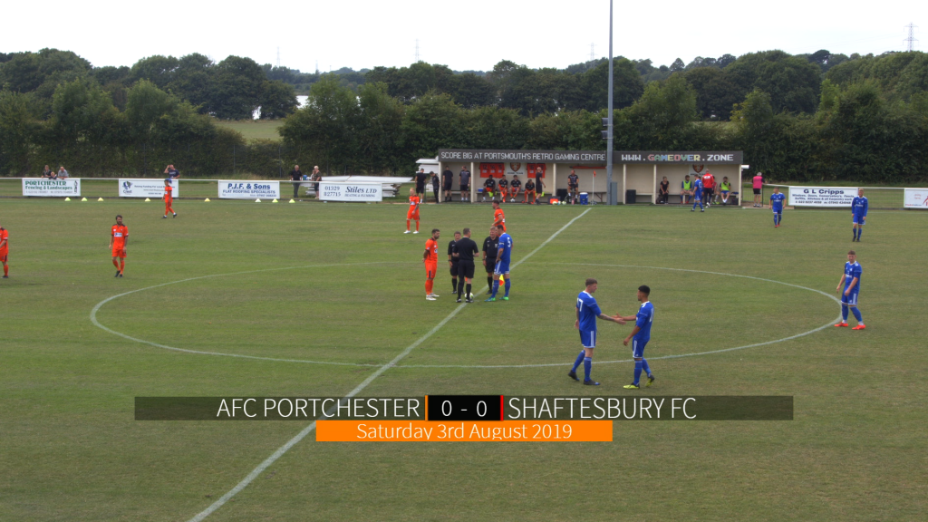 Teams prepare for kick-off at AFC Portchester with a large lower scorebug graphic